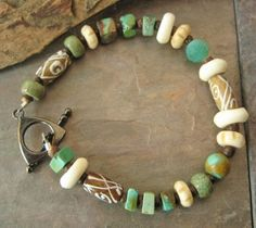KristiBowmanDesign - Jewelry on ArtFire  Soft collection of Turquoise, bone, agate and copper beads in many shapes. All brought together by a simple Gunmetal Toggle Clasp.