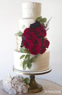 Four  tier wedding cake adorned with red flowers #whiteweddingcake #weddingcake