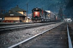 SP, Oakridge, Oregon, 1975 Eastbound Southern Pacific Railroad freight train passing the depot at Oakridge, Oregon, on April 16, 1975. Photograph by John F. Bjorklund, © 2016, Center for Railroad Photography and Art. Bjorklund-84-09-02