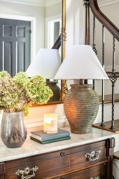 A thrifted $5 table lamp gets a DIY terra cotta paint makeover and new designer dupe look.