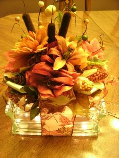"Glass Blocks by Debbie Lea make perfect centerpieces for all Special occasions and Holiday events. Lighted Glass Blocks come with a variety of bows and embellishments giving each glass block a unique look. This Block centerpiece has loads of Harvest fall colors and ribbons. A wonderful addition and special lighted touch in any room or table setting. These blocks are 7.5 x 7.5 x 3"" and battery operated making any location possible."