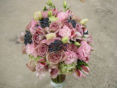Amnesia roses, antique pale pink hydrangea, lizianthus, alstromeria and berries