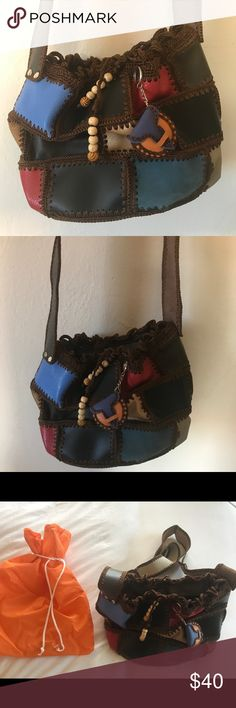 Artisanal hand made purse Not meant to carry meany things, more of a vintage purse to show off. Made in Colombia by indigenous ladies. Absolutely beautiful. Has never been worn, however does not come with tags since it is hand made. Bags