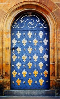 Blue and Gold Arched Door and Entrance / Saint Vitus Cathedral, Prague, Czech Republic