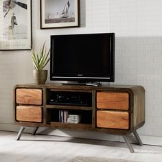 The Reclaimed Iron and Wood TV Unit has a retro feel and style to it. This TV unit is predominantly wood which has round edging giving it a unique style. The central part of this unit has two shelves to store TV boxes and also has two drawers Decor, Furniture, Retro Tv Stand, Corner Tv Unit, Rowe Furniture, Entertainment Center Furniture, Wood Tv Cabinet, Retro Furniture, Wood And Metal