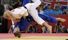 Sarah Clark of Britain competes with Automne Pavia of France in the women's 57-kg judo competition at the 2012 Summer Olympics, Monday, July 30, 2012, in London.