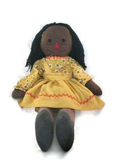 Beautiful hand made African American Mammy Doll.  The rag doll is great piece of Black Americana and history. The doll is wearing a hand made yellow bloomers, a yellow flor... #etsysale #shopsmall #vintageshop #vintagelife #vintagelover #toys