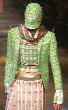 THOM BROWNE......Not sure what is more distrubing, the plaid, the mask, the spikes, the safty pins, the overly zipped skirt, or the peek of fuzzy granny panties!