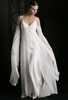 Gabriella wedding dress. Grecian or medieval maiden a very romantic style in ivory silk georgette with hand beaded bodice with crystals and pearls. Flowing overskirt and flattering sleeves give a soft focus outline perfect for slim or larger girls.