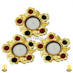 Sudarshan Diya, Designer diya in the shape of Sudarshan chakra studded with bright white and red gems. All auspicious functions and moments like daily worship, rituals, and festivals and even social occasions like inaugurations commence with lighting of lamp, which is often maintained right through the occasion.