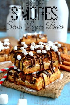 Biscoff Smores Seven Layer Bars - seven layers of gooey marshmallow, rich chocolate and spicy Biscoff cookies! #smores #biscoff