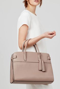 The only bag of its kind—our Italian leather work satchel is the ideal essential for day-to-night polish. Crafted in Italy from premium leathers, this functional yet elegant piece is complete with a laptop sleeve, zipper pocket and adjustable crossbody strap.Complete the look with a tonal tassel for a chic flourish. Tassel not included (Shop here).