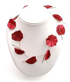 "MARIE-JOSE HOEBOER (1959) - ""Flower-necklace"" of red silk and silver strung together as daisies, design & execution 1996, the Netherlands"