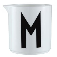 Milk jug for the porcelains cups with Arne Jacobsen Typography
