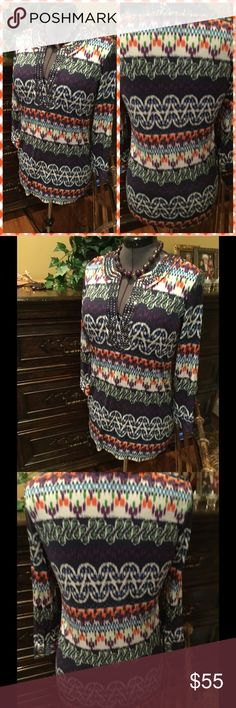 ♦️Tory Burch split neck tunic Gorgeous tunic by Tory Burch.  Shades of blue, orange, green, purple with split neckline.  Neckline has beaded detail.  Size large.  In excellent condition. Tory Burch Tops Tunics