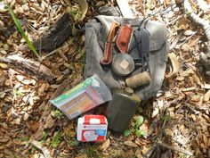 """bushcraft haversack with firemaking kit, cordage, shelter & lightstick, First Aid kit, a flask of water, and ESEE-KA-BAR-BECKER collaboration """"Eskabar"""" neck knife. Perfect light kit for a dayhike."""