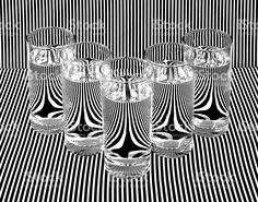 Fine Art Photograph Water Filled Glasses Refracting Black White Stripes royalty-free stock photo