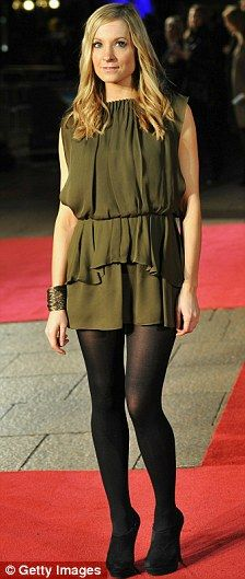 Olive dress with black tights & booties. Beige outer coat.