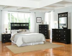 White Master Bed With Chic Black Wooden Dressing Table And Clean Parquet Floors