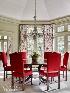 The octagonal dining room reveals rich red chairs from Holland and Co. and a New Classics dining table through Ainsworth-Noah. Red Dining Chairs, Dining Area, Dining Rooms, Red Chairs, Dining Tables, Window Treatments Living Room, Living Room Windows, Living Spaces, Cheap Chairs