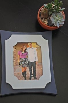 snap and point picture frames. you don't need to remove from wall to swap pictures.