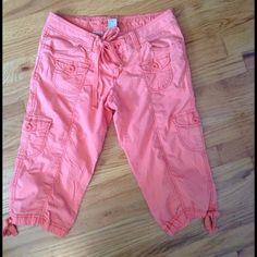 📦 🎀Capri Orange Pants🎀 Capris. Very comfortable. Arizona Co Brand. Size 3. Excellent Condition. No Flaws. Color Is Orange. No matter how many pictures I took it still came out pink 😞 lol idk why. It's a pretty color orange tho. Any questions please ask me Arizona Jean Company Pants