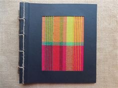 "This colorful book is extra special! It has a colorful handloomed fabric cover and 21 pages of handmade paper. It is 9"" x 10 1/2"" making a special photo album, sketchbook, or scrapbook.  In addition, it is a Fair Trade product, made from 100% recycled paper and made with handloomed and dyed fabric. The colors and look are inspired by the colorful  people, land and seascapes of Sri Lanka. http://www.athousandbutterflies.com/Sri-Lankan-Handloom-Sketchbook-Photo-Album-p/tbt-slhs-pa.htm $26.95"