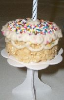 Birthday cake shaped Rice Krispy treats.  See more first boy birthday snacks and party ideas at one-stop-party-ideas.com