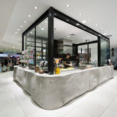 Sweet shop in Tokyo by Schemata Architecture Office with a concrete counter cast in a fabric bag.