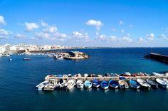 Un parcheggio di barche in un'immensità di blu. #Salento #WeekendPuglia