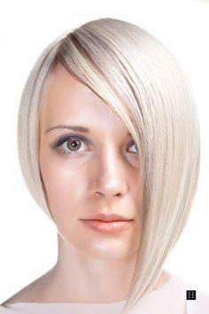 womens short assymetrical bob hairstyle blonde hair.