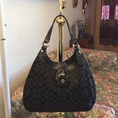 "AUTHENTIC COACH SOHO SIG LARGE HOBO SHOULDER Bag AUTHENTIC COACH SOHO SIGNATURE LARGE HOBO SHOULDER PURSE  Silver tone hardware  Interior has 3 compartments (2 compartments with snap closure, middle compartment with zip closure)  Inside zip pocket and multifunction pockets  Measurements approximately: widest part at bottom 14.5"" (L) x 10.5"" (H) x 4"" (W), handles with 9"" drop  100% Authentic  Comes From A Smoke Free & Pet Free Home Coach Bags Hobos"