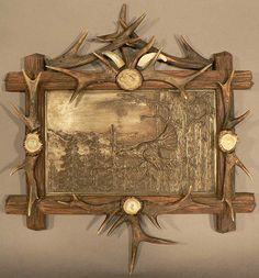antler picture frame with tin relief