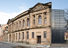 The titles of works of literature are engraved into this extension to a sandstone library in Glasgow, refurbished to create a centre for women's history