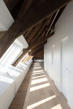 wooden beams, angles, + window light make for a beautiful walkway
