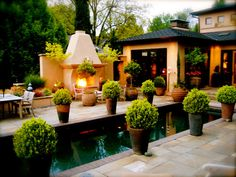 Decorative Patio Pool Planters Formal Touch Boxwood planters surround the pool, fireplace and lounging areas on this patio. Outdoor Rooms, Outdoor Gardens, Outdoor Living, Outdoor Decor, Patio Design, Garden Design, Hardscape Design, Boxwood Planters, Garden Planters