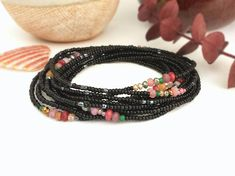 Deep dark ebony seed beads are the backdrop for crystals in shades of Rose, Plum, Sage and Copper. This one has a mysterious vibe that reminds me of a dark fairy tale. It is an extra long strand on stretch cord you can wrap around your wrist, ankle or neck, It will wrap 12 times on an