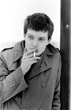 Ian Curtis of Joy Division. Hulme, Manchester. January 6, 1979. Photo: Kevin Cummins.