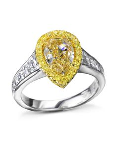 18 karat yellow gold and platinum ring set with a carat pear shaped fancy yellow diamond center surrounded by 53 fancy yellow diamonds in a halo CTW) and French-cut diamonds CTW) on the band. Yellow Diamond Rings, Diamond Bands, Yellow Diamonds, Unique Diamond Engagement Rings, Designer Engagement Rings, Platinum Ring, Ring Designs, Pear Shaped, Halo
