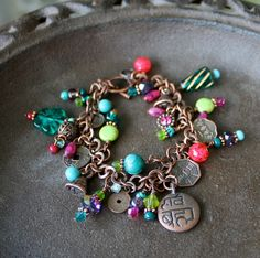 Charm Bracelet - Colorful Charms on Copper Chain, Pink, Green, Teal, Purple. $27.00, via Etsy.