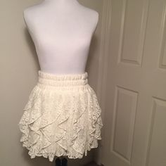 White lace ruffle skirt White flirty lace skirt with white living. Elastic waistband. Worn only once. Can be dressed up or down. Excellent condition. 100% Polyester. Smoke free and pet free home. Bundle 2 or more items and get 15% off! Offers welcomed! 🙌 Rachael & Chloe Skirts