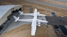 In this May photo provided by Stratolaunch Systems Corp., the newly built Stratolaunch aircraft is moved out of its hangar for the first time in Mojave, Calif. via AP)World's biggest plane takes flight Microsoft, Hercule, Air Space, Football Field, Boeing 747, World's Biggest, Worlds Largest, Fighter Jets, Aircraft