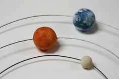 Make a model of the Solar System.....tutorial in Spanish but it seems self-explanatory thanks to the photos