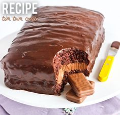 TIM TAM CAKE   (recipe via raspberricupcakes.com )     INGREDIENTS       4 large eggs   110g (½ cup) caster sugar   65g cornflour (c...