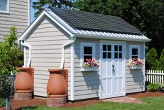 """Nifty little set-up. Shed with solar panels running power to our home and rain collection barrels to supply vegetable garden. """"Perfect"""" Shed Plans So Clear, So Complete, So Easy To Use. The Shed Practically Builds Itself Rain Collection Barrel, Water Collection, Shed Organization, Storage Shed Plans, Diy Storage, Storage Ideas, She Sheds, Potting Sheds, Shed Design"""