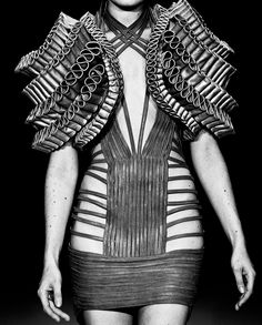 Wearable Art - leather dress with tiered 3D shoulder structure - sculptural fashion; three-dimensional fashion design // Iris van Herpen Haute Couture