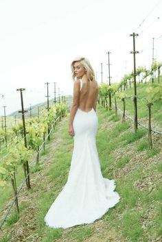 Katie May Backless Wedding Gown: Sienna Gown. Photo courtesy of Nicole L. Hill Photography. www.katiemay.com DREAM Used Wedding Dresses, Low Back Wedding Gowns, Lace Wedding Dress With Sleeves, Lace Mermaid Wedding Dress, Elegant Wedding Dress, Backless Wedding, Bridesmaid Dresses, Backless Gown, Gown Wedding