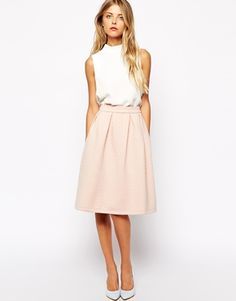 be on trend in this vila quilted a line midi skirt from asos a steal at $40