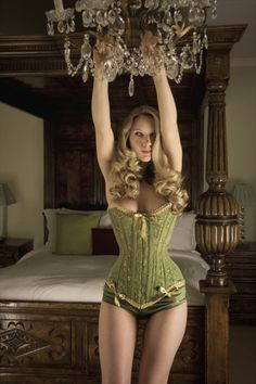 What an unusual colour of green - I'd love to swing from the chandeliers in this corset!