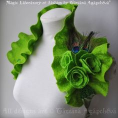 So, I've only had absinthe once, but the color is so pretty and the lovely lore behind the drink is too good to pass up. I love absinthe inspired goodies! Felted bolero with rose and peacock feathe...